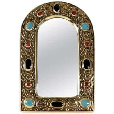 «Miroir bijou» en céramique émaillée dorée datant des années 1960 par François Lembo.