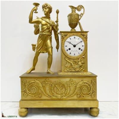 Pendule empire bronze doré au mercure, sujet Bacchus, signée Duval à Paris, mouvement avec suspension à fil de soie, haut. 44 cm, (1810-1820)