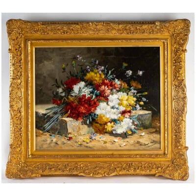 Henri Cauchois (1850 – 1911) : Bouquet d'oeillets sur un entablement.
