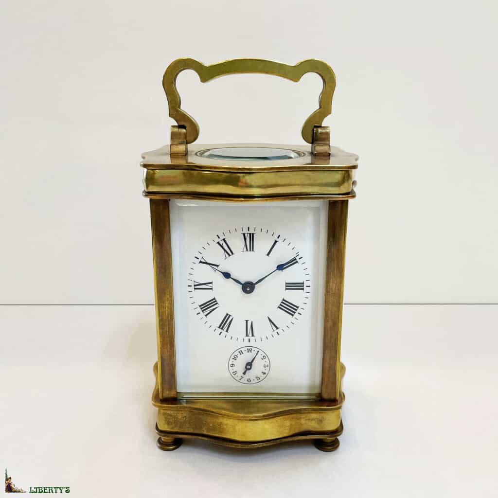 Pendulette de voyage cage bronze avec réveil, haut. 11 cm, (Fin XIXe)