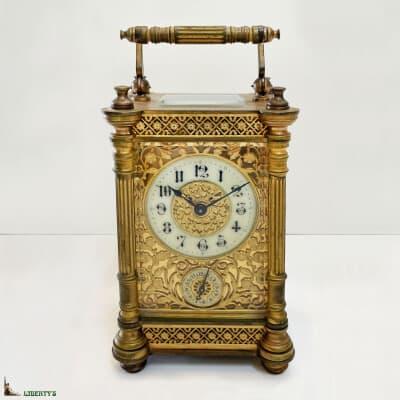 Pendulette de voyage cage bronze avec réveil, haut. 13 cm (Fin XIXe)