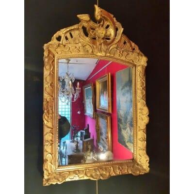 Miroir à Fronton Époque Régence – Décors Florale – Bois Sculpté Doré – 18ème